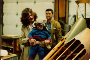 My mom holding my brother Josh by Grandpa Bill's Bi-Plane