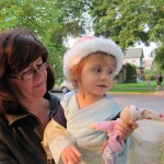 Gianna Watching the Parade with Grandma
